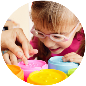 Young girl working with an occupational therapist
